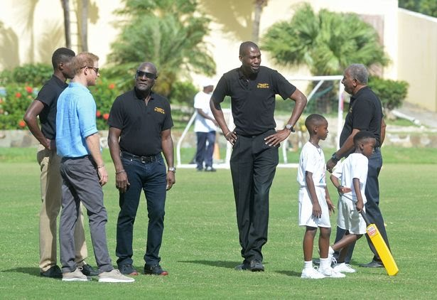 Prince Harry is hosted by three Antigua & Barbuda's cricketing legends; Sir Viv Richards (left), Sir Andy Roberts (right) and Sir Curtly Ambrose (middle)